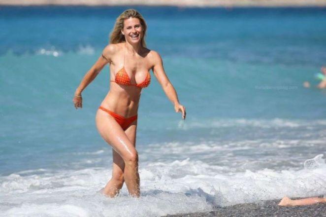 Michelle Hunziker In An Orange Bikini On The Beach In Varigotti