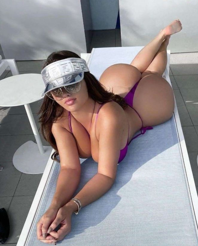 Anastasia Kvitko Spotted Relaxing In Purple Bikini