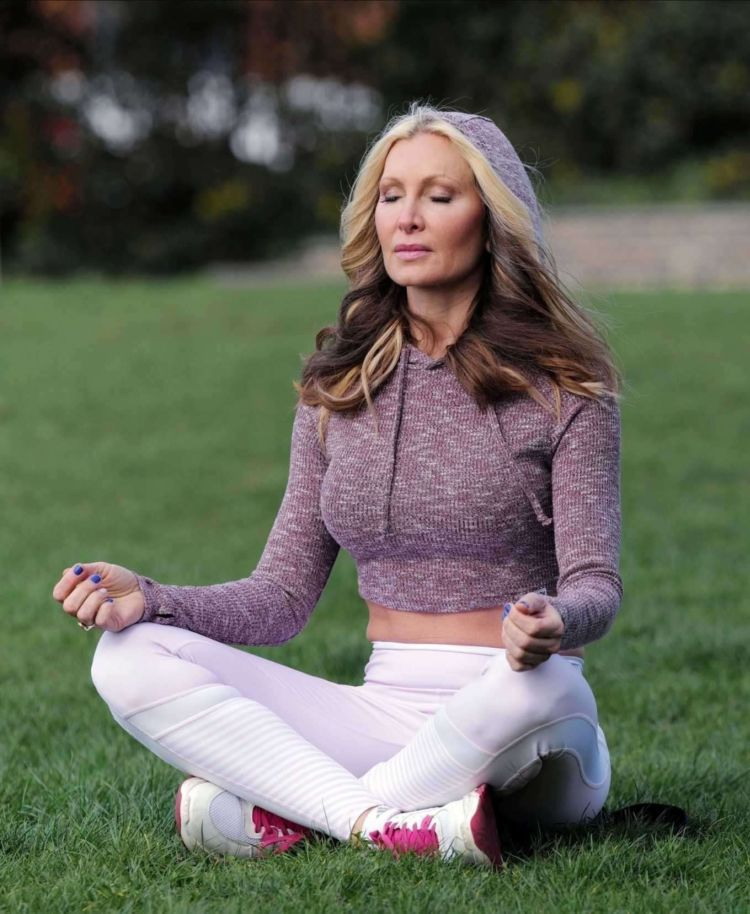 Caprice Bourret Practicing Yoga In A Park In London
