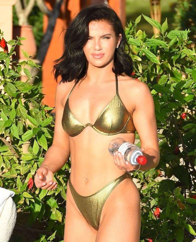 Alexandra Cane Shines In A Golden Bikini At A Pool In Tenerife