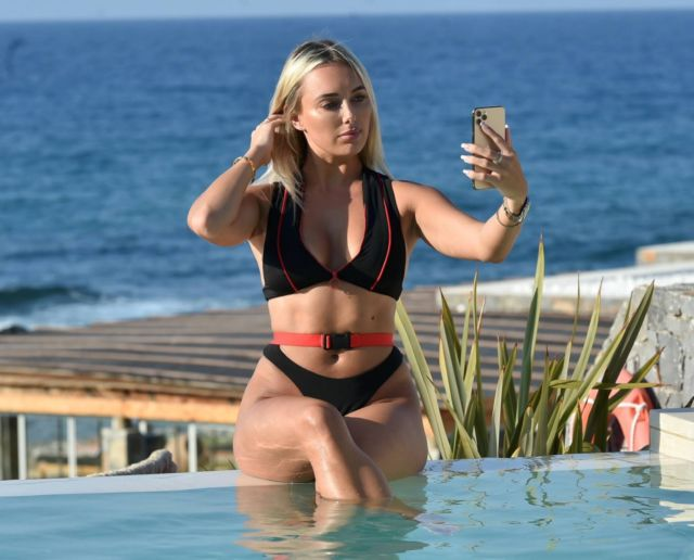 Amber Turner Poses For A Bikini Shoot By Swimming Pool In Crete