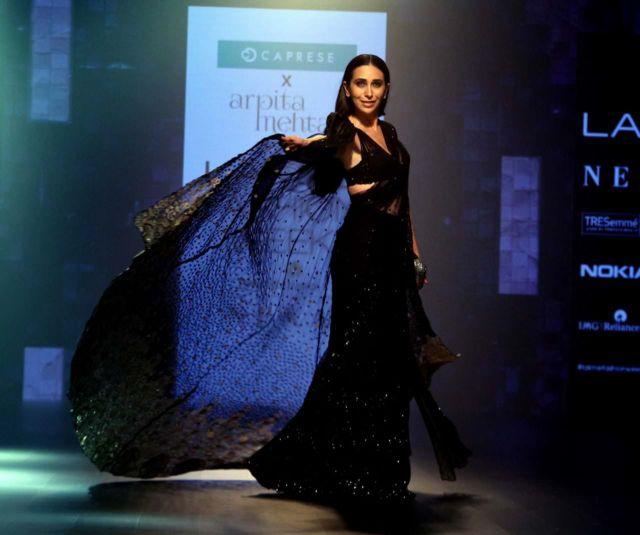 Karisma Kapoor Walks The Ramp In A Bejewelled Black Saree