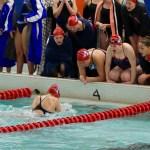 Apollo Swim Team cheering their teammate on.