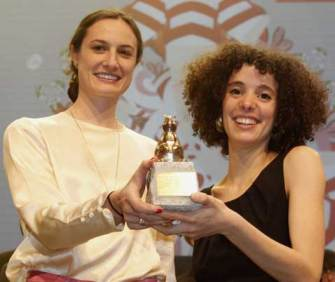 "Malika Zouhali-Worral and Katherine Fairfax Wright accept award for ""Call Me Kuchu"" at Berlin International Film Festival. (Photo courtesy of Teddy Awards)"