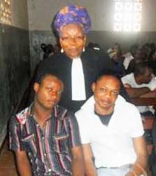 Jonas Singa Kumie and Franky Djome, with their attorney, Alice Nkom.