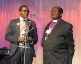 Ugandan activists Pepe Julius Onziema, left, and Bishop Christopher Senyonjo at Clinton Global Initiative 2012 in New York. at