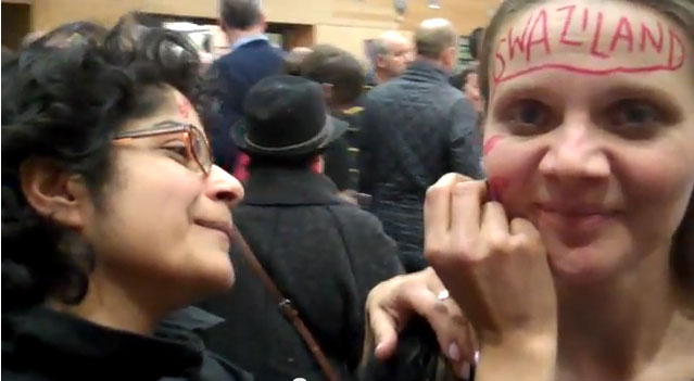 "Protester in Brighton has her face labeled ""Swaziland"" in hopes that the country will repeal its anti-gay law. (Click image for video.)"