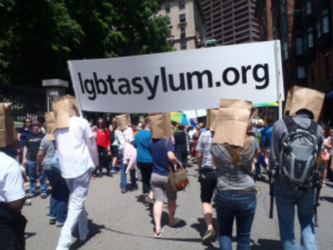 Marchers with bags on their heads remind Bostonians of the traumas faced by asylum seekers and those who remain behind in 76-plus countries with anti-gay laws. The protest was organized by the LGBT Asylum Support Task Force. (Photo courtesy of the O-Blog-Dee blog).