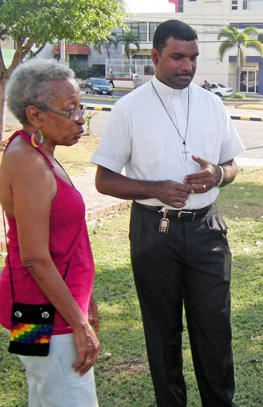 Yvonne McCalla-Sobers and the Rev. Sean Major-Campbell chat during the Christmas dinner for homeless LGBT youths.