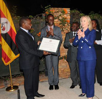 Adrian Jjuuko (left), executive director of HRAPF, was a representative of the Civil Society Coalition on Human Rights and Constitutional Law when it received the U.S. Human Rights Defenders Award from then U.S. Secretary of State Hillary Clinton (right) on Aug. 3, 2012. The ceremony took place at the U.S. Embassy in Kampala. (Photo courtesy of HRAPF)