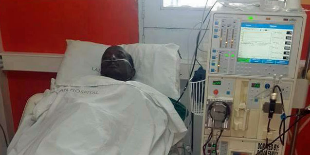 Muhadh Ishmael in his hospital bed on Dec. 17, before his death on Dec. 21. (Photo by Joseph Odero)