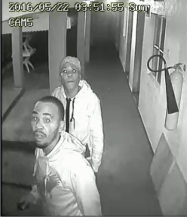 A security camera captured this photo of two of the four burglars who break into the offices of HRAPF on May 22 and killed a security guard.