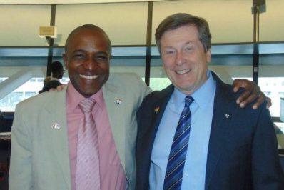Maurice Tomlinson poses with Toronto Mayor John Tory (Photo courtesy of Maurice Tomlinson)