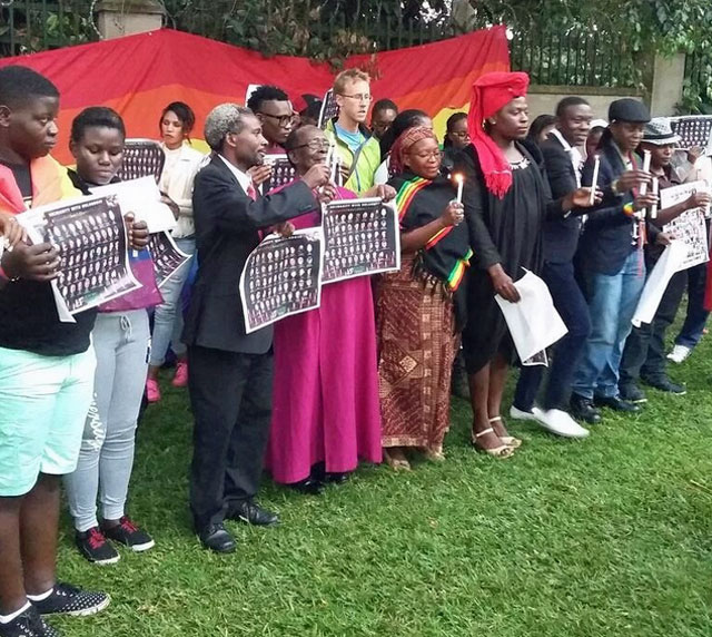 Members of Uganda's LGBTIQ community and allies gather for yesterday's vigil for victims of the June 12 massacre in Orlando. (Photo courtesy of Kasha Jacqueline via Twitter)