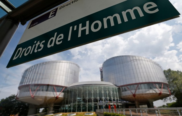 "French-language sign at a tram stop reads ""Human rights"" in front of the European Court of Human Rights in Strasbourg, France. (Photo courtesy of Newsweek) REUTERS/Vincent Kessler (FRANCE - Tags: POLITICS SOCIETY CRIME LAW) - RTX11ZWV"