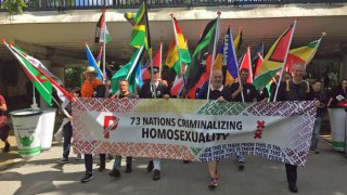 Protesters at Pride Walk carried flags of 73 nations with anti-homosexuality laws. The Erasing 76 Crimes blog helped to identify those countries and gay-rights activists who deserved recognition for their work there. (Photo courtesy of Pride Walk)