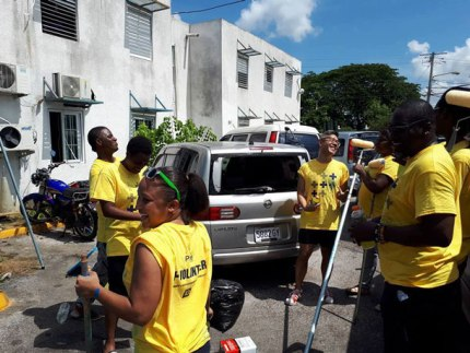 LGBT community members prepare to paint the Freeport Police Station as Montego Bay Pride's 2017 social service project. (Photo courtesy of Maurice Tomlinson)