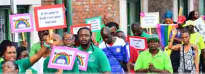 """Christian marchers carried signs such as """"Belong to God"""" and """"In the Name of Jesus Every Knee Shall Bow"""" (Photo courtesy of Nation News)"""