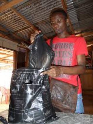 Before a visit to LGBT prisoners at the Yaoundé Central Prison, activist Jean Jacques Dissoke prepares food packages.