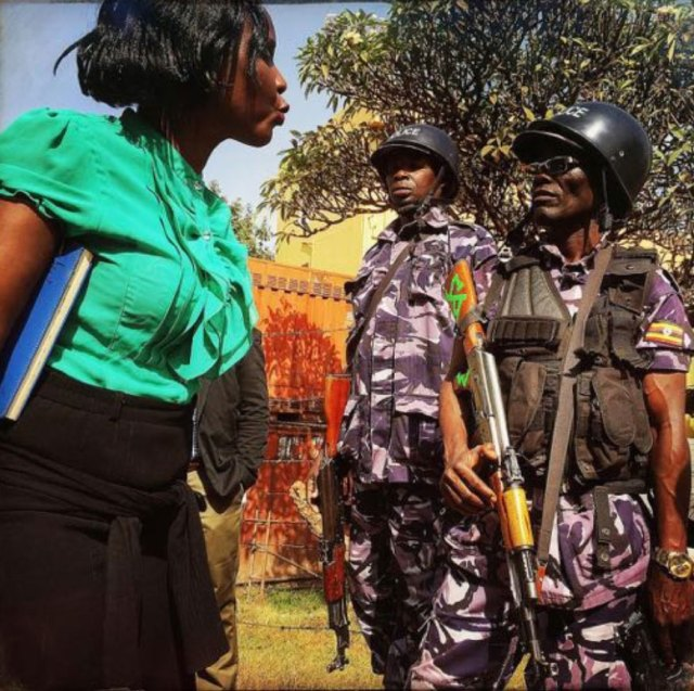 HRAPF legal officer Betty Balisalamu confronts poilce during the Feb. 12 sit-in at the Old Kampala Police Station. (Frederic Noy photo courtesy of HRAPF)