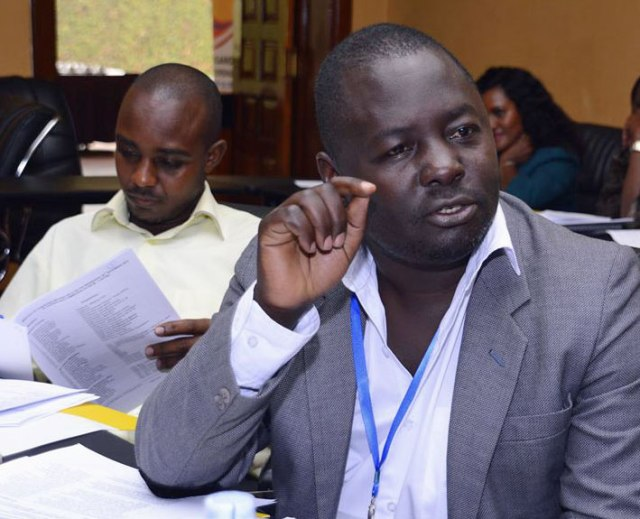 Kikonyogo Kivumbi (right) at his first meeting the Country Coordinating Mechanism board in 2015, where he represented LGBTI people, men who have sex with men (MSM), sex workers and intravenous drug users. At left is his elected alternate, Jude Ayebare.