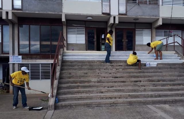 Volunteers from Montego Bay Pride paint the steps at Cornwall Regional Hospital. (Photo courtesy of Maurice Tomlinson)