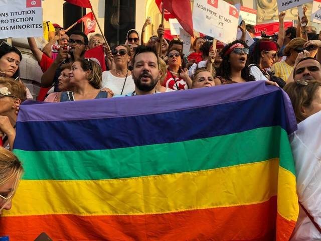 Shams President Mounir Baatour holds a rainbow banner during an August 2018 demonstration in Tunis for equality and individual liberties. (Photo courtesy of Mounir Baatour)