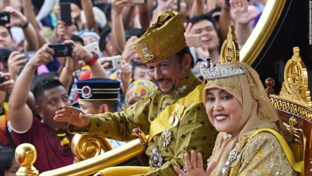 The sultan of Brunei and his wife. (Photo courtesy of CNN)