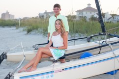 Young couple on a boat at the beach