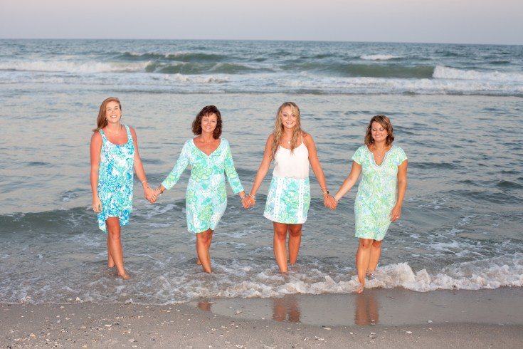 Family holding hands on the beach in Myrtle Beach
