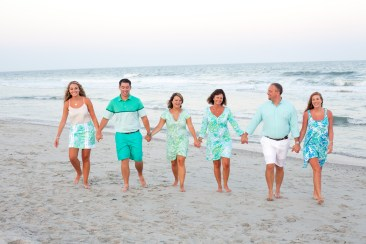 Family holding hands on the beach