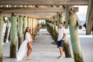 Beautiful maternity photos under the Myrtle Beach pier