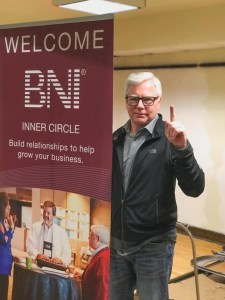 Interview-Attorney William J. McCabe. Criminal defense law. Image of Bill in a black sweater at a fundraising event with a BNI sign.