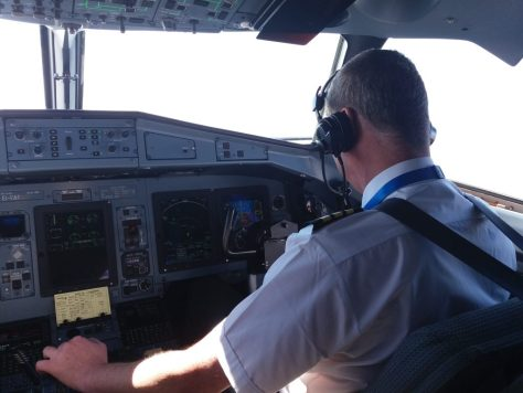 At the controls.