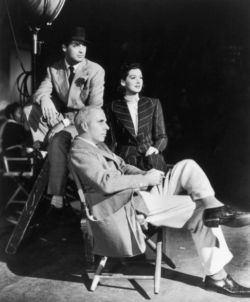 Howard Hawks on the set of His Girl Friday (1940) with Rosalind Russell and Cary Grant.