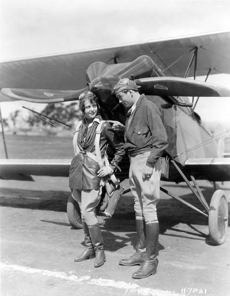 Sue Carol and David Rollins in The Air Circus (1928), Howard Hawks' first film set in the world of aviation. Here they are stunt flyers.