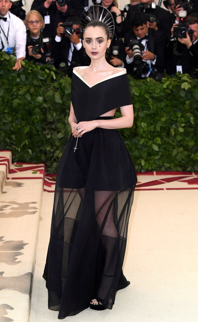 Lilly Collins attends the Heavenly Bodies: Fashion & The Catholic Imagination Costume Institute Gala at The Metropolitan Museum of Art on May 7, 2018 in New York City.