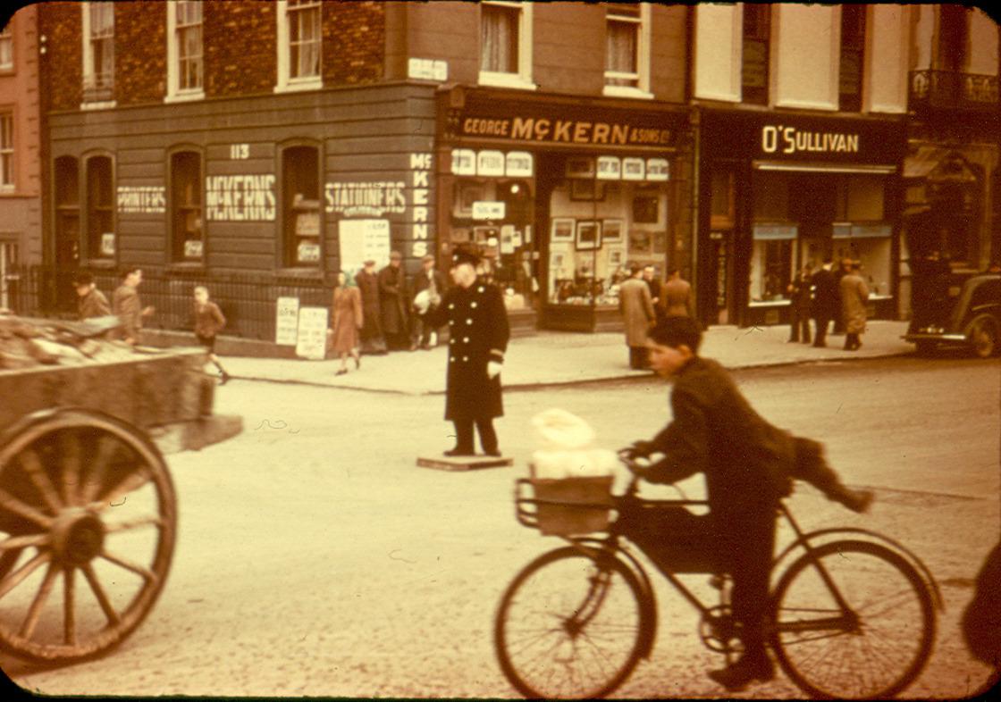 Cop directs traffic, Limerick, Ireland, circa 1940. – History
