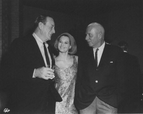 John Wayne, Angie Dickinson and Howard Hawks sometime after filming Rio Bravo