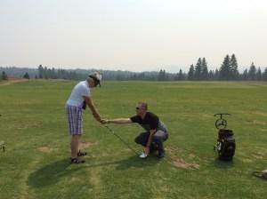 Adams checking Ruth's grip.