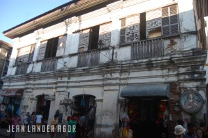 Stores that sell various wares occupy the lower levels of the old houses along Calle Crisologo