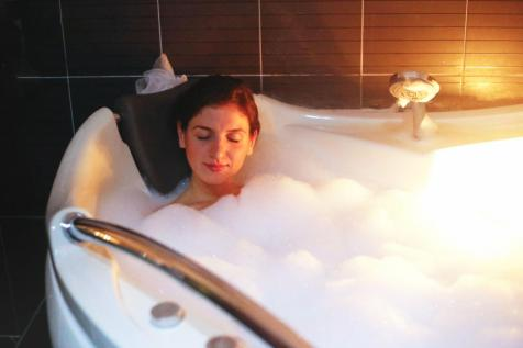 woman-relaxing-in-hot-tub image 0