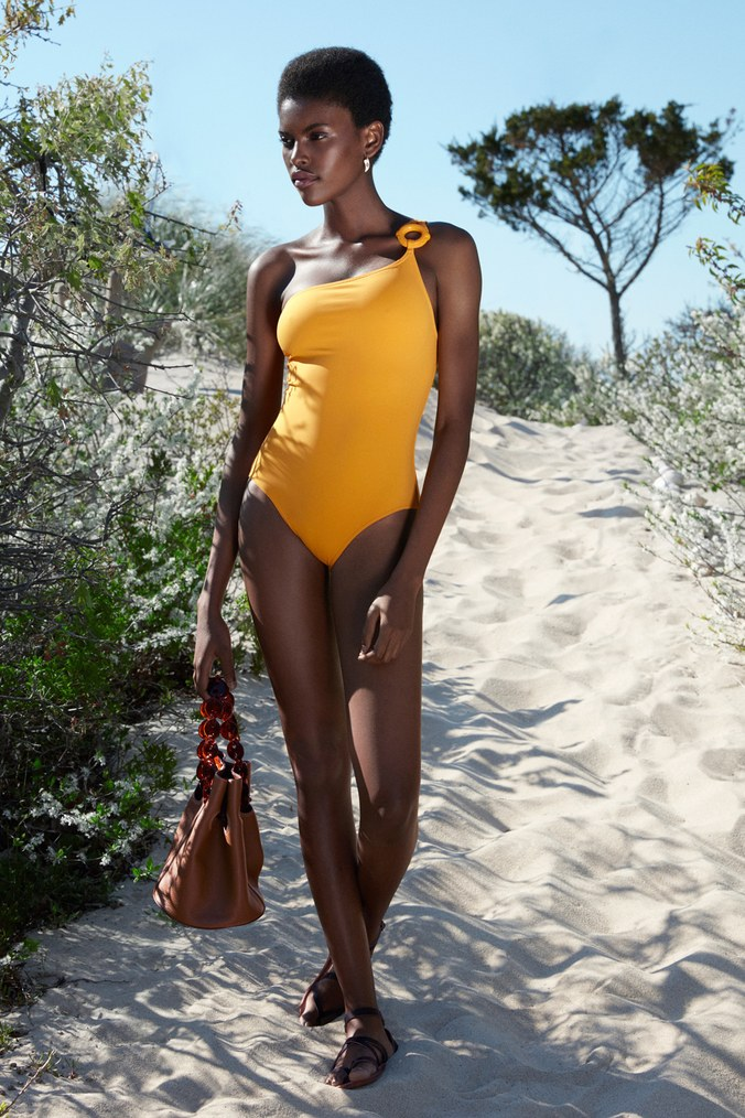 Estevão wears a Hermès one shoulder swimsuit, Mansur Gavriel bag, and K. Jacques sandals. Photo by Easton and Roso, styled by Caroline Grosso.