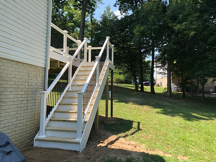 New Pressure Treated Wood Deck In Chesapeake Beach 7Th State   Pressure Treated Wood Stairs   L Shaped   Exterior   Timber   45 Degree Stringer   8 Foot