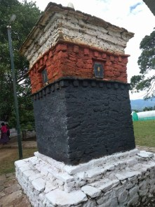 The black dzong that denotes the burial place of the demoness