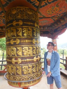 Me playing with the prayer wheel
