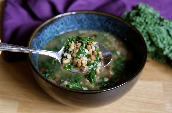 This Vegan Freekeh Soup with Du Puy Lentils and Kale will keep you full thanks to plenty of fiber and for relatively few calories. Recipe by media dietitian Christy Brissette 80 Twenty Nutrition