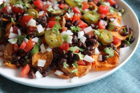 Sweet Potato Nachos - Vegan, Paleo, Gluten-Free - with black beans and avocado crema - recipe by Christy Brissette best healthy food blogger and media registered dietitian nutritionist and President of 80 Twenty Nutrition in Chicago