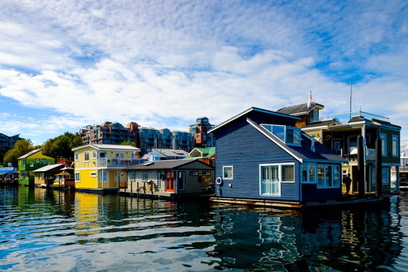 Gaze at the colorful floating homes bobbing near the opening of the Inner Harbour. Photo: Leigh-Miller