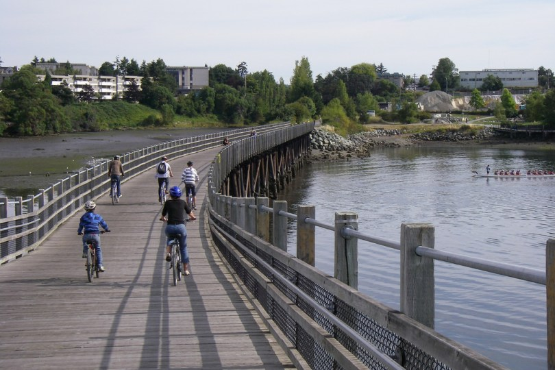 Roll across wooden bridges along the Galloping Goose Trail. Photo: Harold